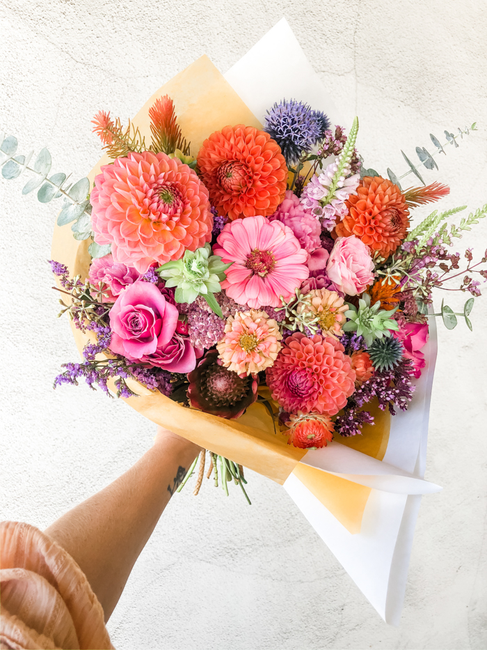 A bold and colorful bouquet created by Tabitha Abercrombie of Winston & Main, featuring local & seasonal blooms like dahlia & zinnia.