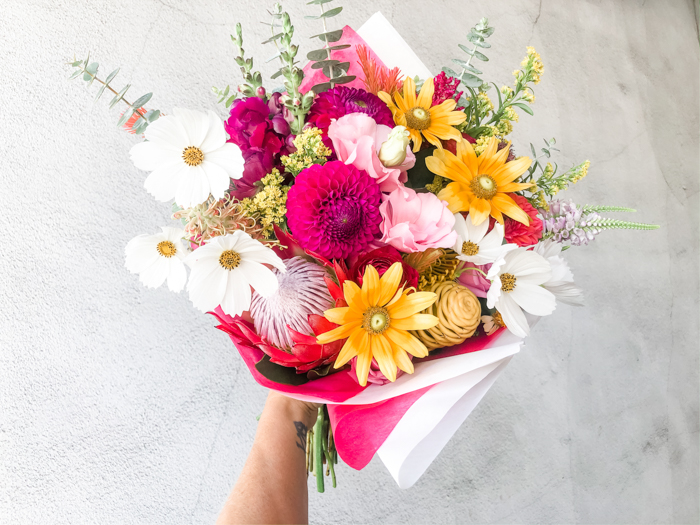 A bold and local bouquet by Tabitha Abercrombie of Winston & Main, featuring dahlias, cosmos, and rudbeckia.