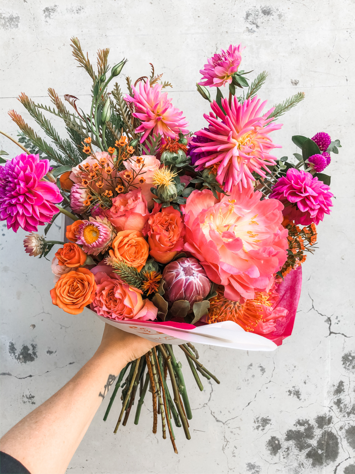 Bold pink bouquet featuring peonies, dahlias, spray roses and more from Winston & Main, Los Angeles, CA.