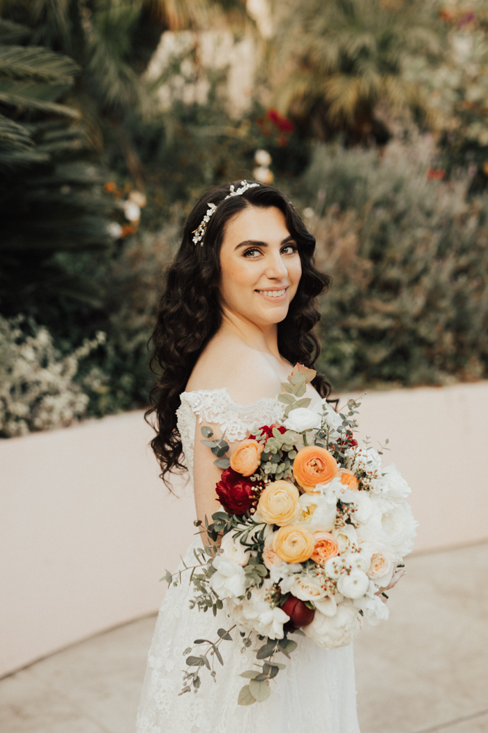 A bride and her beautiful Winston & Main bouquet, photographed by Heirlume Photography at The Bel Aire Hotel.